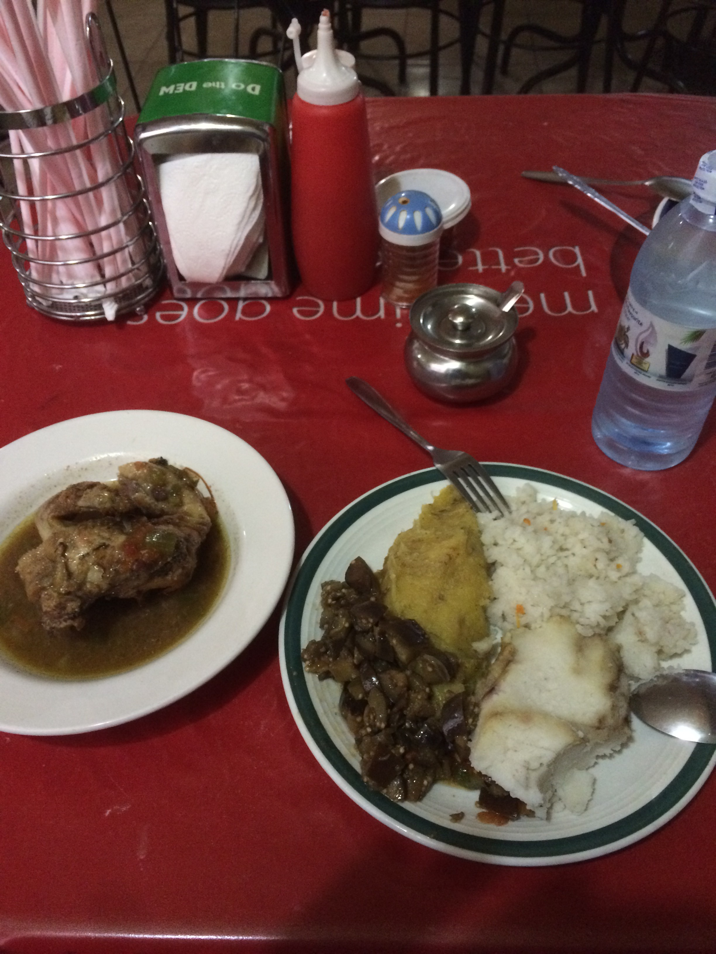 My first Ugandan meal: beef, matooke (cooked bananas, different from the sweet), rice, eggplants and semolina